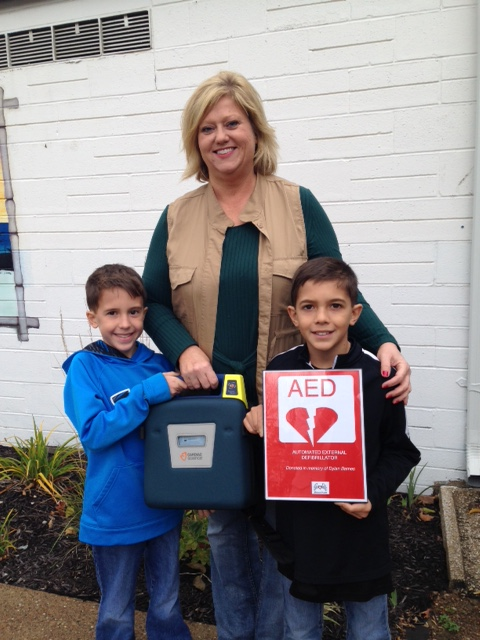Brian's Heart, Inc. donates AED to Memorial's Youth Cross-Country Program