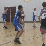 Boys Varsity B Basketball secures their first win over OLL