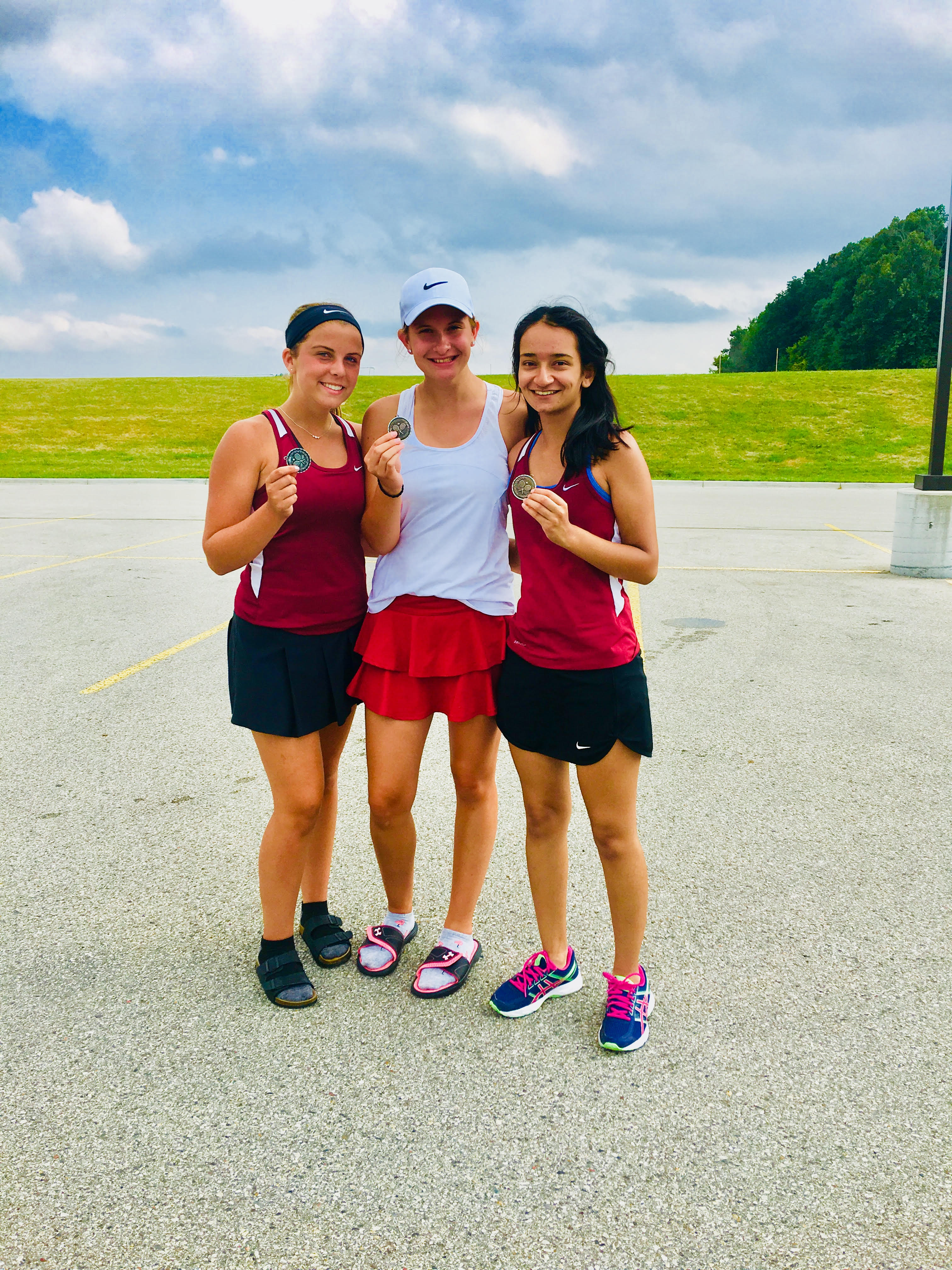 4 EAST TENNIS ATHLETES TAKE HOME MEDALS