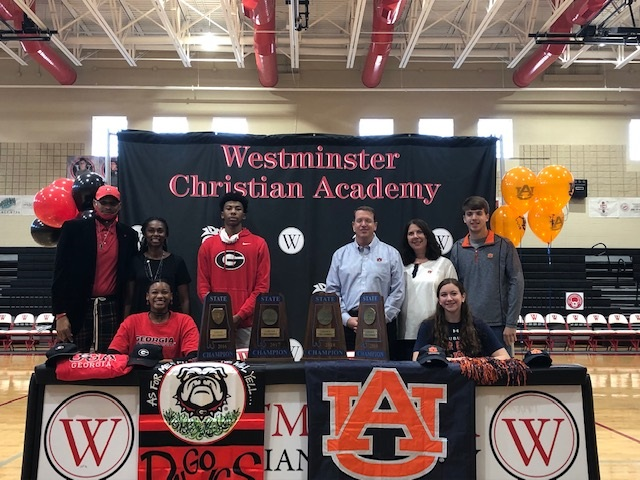 Rebekah Hamilton and Eboni McCarty sign swimming scholarships