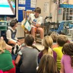Basketball B Team Reading to Pinckney Elementary