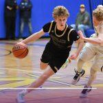 Boys Varsity Basketball falls to Columbia Christian 100 – 49