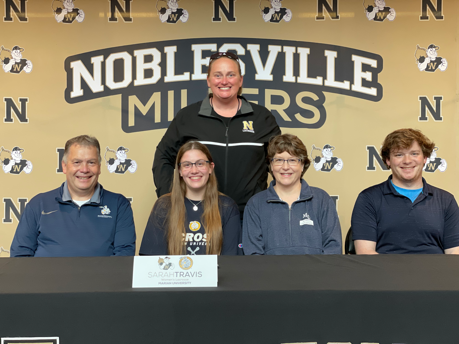 Sarah Travis signs with Marian University
