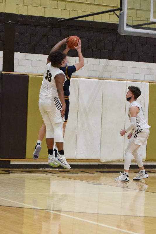 Boys Varsity Basketball vs. Freeport (Photo Courtesy of Kathy Kemp)