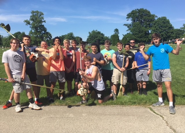LHS Basketball and Football Players Participate in Community Service Project!