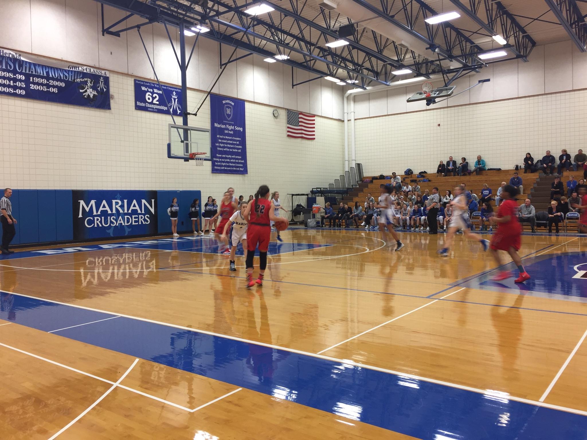 Omaha South High School Girls Varsity Basketball beat Marian High School 62-57