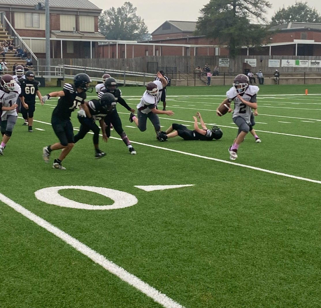 Colton Carroll rushes past defenders