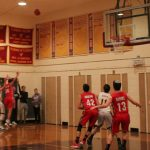 Varsity Hoops Stages Classic Comeback; Tops off Sweep at the Falcons Nest