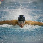 Swim and Dive Competes at Metros