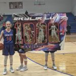 Lutz scores her 1000th point in overtime thriller