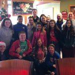 Girls Basketball Volunteers at Breakfast with Santa for MDA