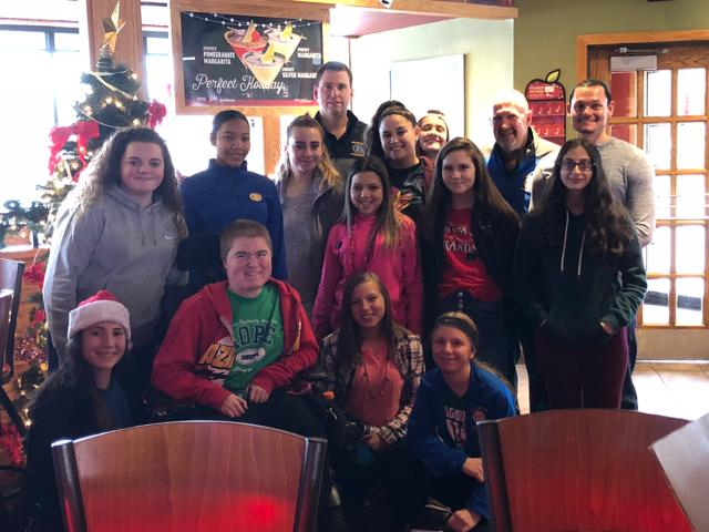 Girls Basketball Volunteers at Breakfast with Santa for MDA