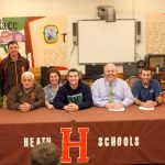 Payton Booth and Jacob Kennedy sign to play college sports