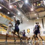 Trojan Women Win, Men Fall in Basketball Season Openers