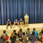 Football players speak at Deale Elementary