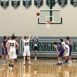 De Soto High School Boys Varsity Basketball falls to Louisburg High School 48-53