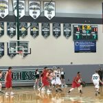 De Soto High School Boys Varsity Basketball falls to Ottawa High School 34-45