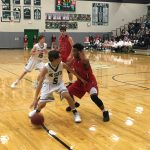 De Soto High School Boys Varsity Basketball falls to Ottawa High School 64-59