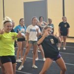 Cheerleaders having some fun between routines…