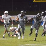 Olympia High School Varsity Football beat East River High School 20-13