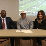Tariq Beach Signs with Walsh
