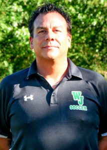 boys varsity co-coach hector morales