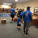 Forney ISD Athletes Help with District Library Move!