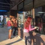 FC Cheerleaders paint windows for homecoming