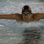 Boys Varsity Swimming beats Highland 83 – 79