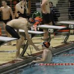 Boys Varsity Swimming beats Knox 84-81 in a Nail Biter