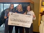 Athletics Receives Generous Check from Urgent Care