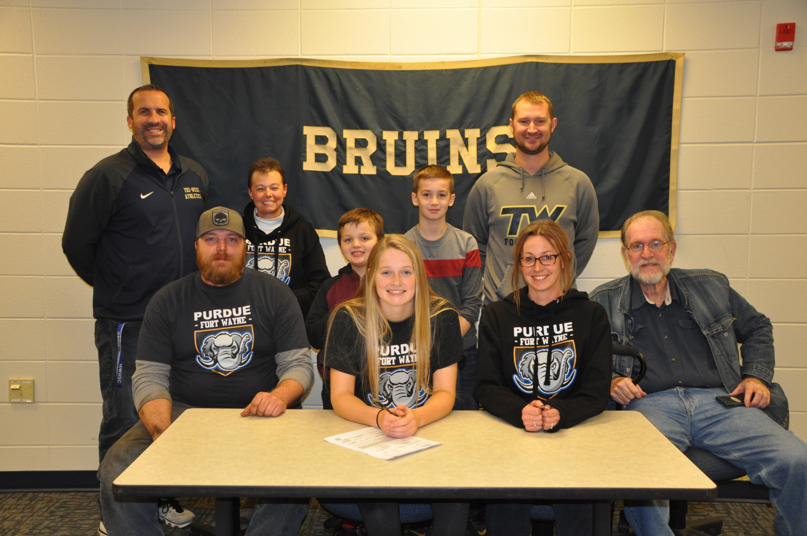 Payton Waling Signs for Track & Field