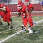 Freshman Red dodges a late charge from Cove, answers with late TD in 33-23 win
