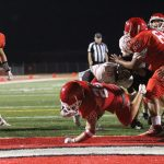 Freshmen Red bounces back from Heights' flurry to claim win, 42-28