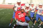 Pounding the rock: Four rushing TDs power JV White past Midway, 29-14