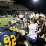 Superintendent Brent Wilson addresses teams after Rivalry Game