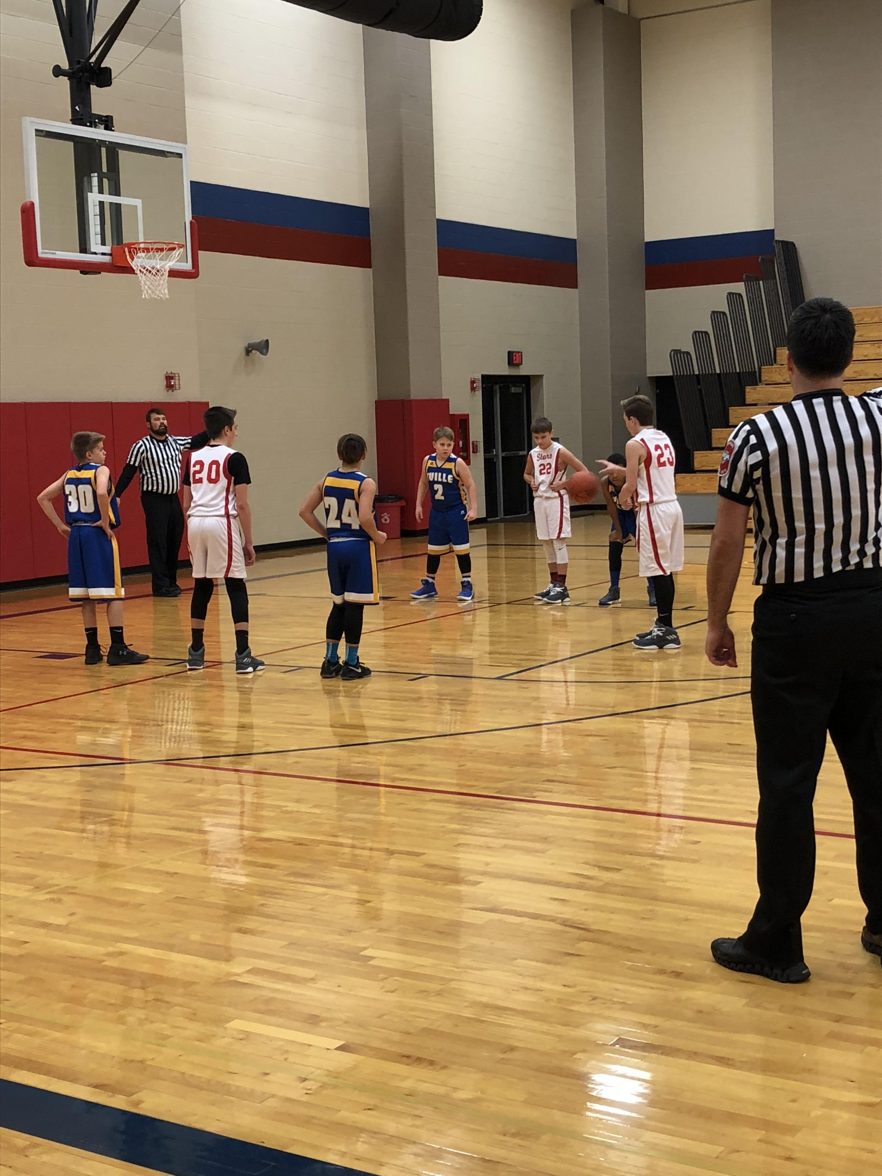 6th Grade Basketball Sweeps the Athenians