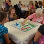 WHS Cheer Team Shares An Evening of Fun with Sander's Glen Residents