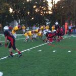 Freshman Football Tackles Scecina