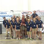 archery team poses with trophy