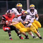 Football action against Grand Blanc