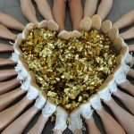 Heart shaped Poms surrounded by Pom participants shoes.