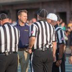 Athletic Director JD Wheeler talks with the officials before the game