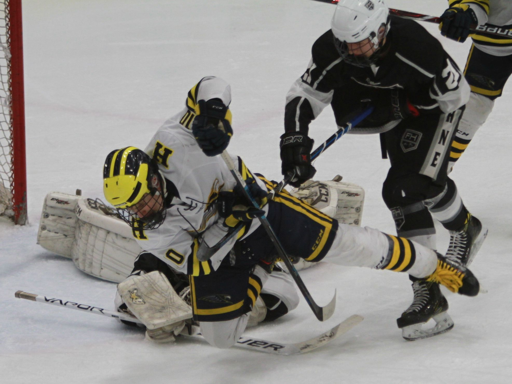 Hartland's Adam Pietila goes to the ice while trying to get to the puck around the Forest Hills Eastern net during a 6-0 victory in the state Division 2 hockey quarterfinals in Flint on Tuesday, March 5, 2019.