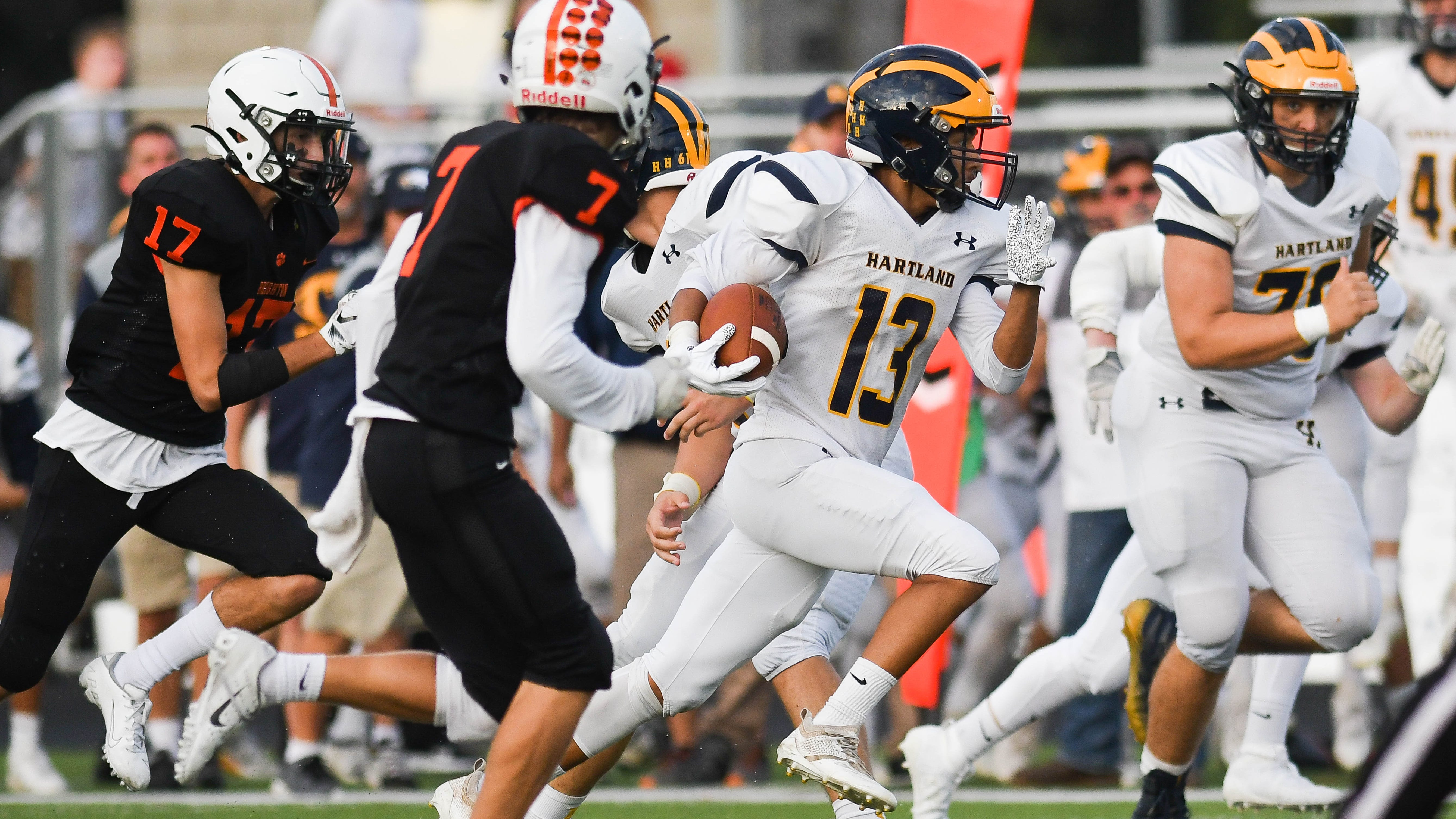 Hartland's Isaac Elmore (13) caught a 69-yard touchdown pass to open the scoring in a 35-7 victory over Northville.