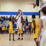 Boys Basketball Defeats North