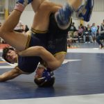 Colby Simon and Kody Arntz Lead Wrestling Team at North Coast Classic