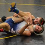 High School & Middle School Students Ride the Spectator Bus to Regional Wrestling at Holton