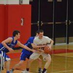 JV boys basketball battle back, fall short against Kenowa Hills