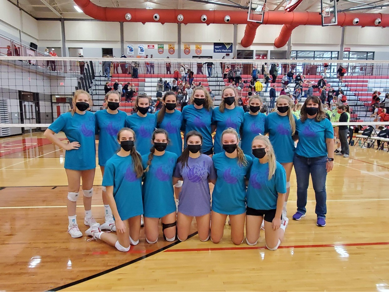 Varsity volleyball goes undefeated at Volley against Violence quad on Saturday